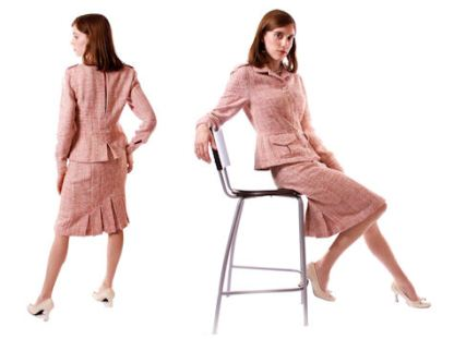 Pink boucle military jacket with matching pencil skirt.